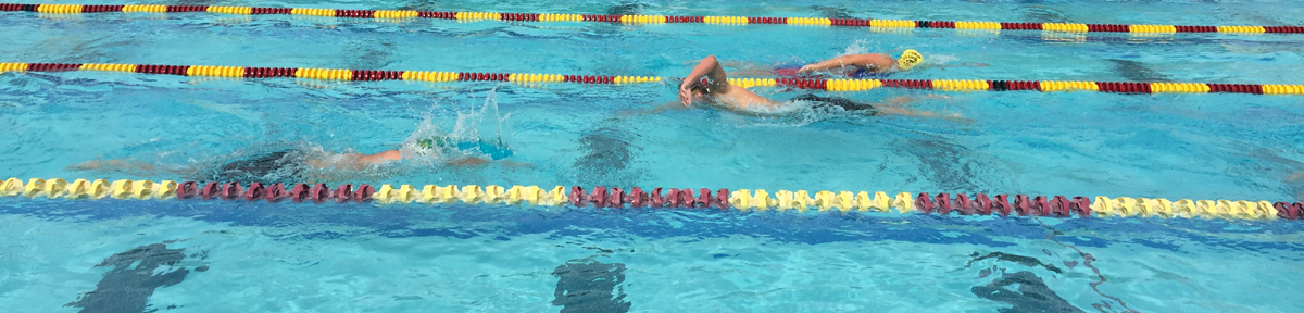 three swimmers in the De Anza pool