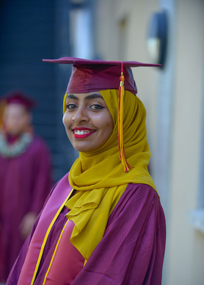 student in graduation robe