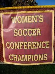 Women's Soccer Conference Champions banner at the soccer field