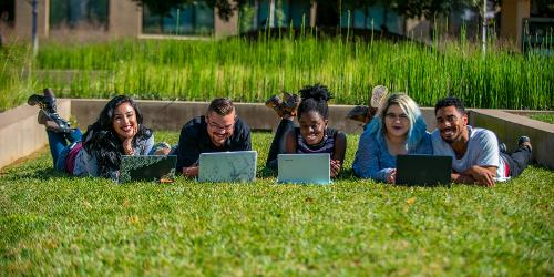 Students with laptops (students-grass-laptop.jpg)