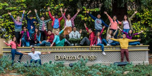 Students on De Anza sign (students-on-main-sign.jpg)