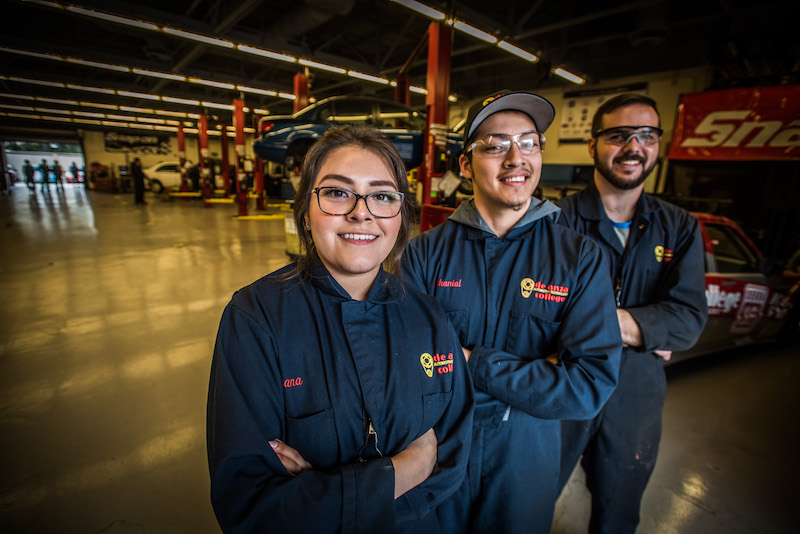 three auto tech students with arms crossed