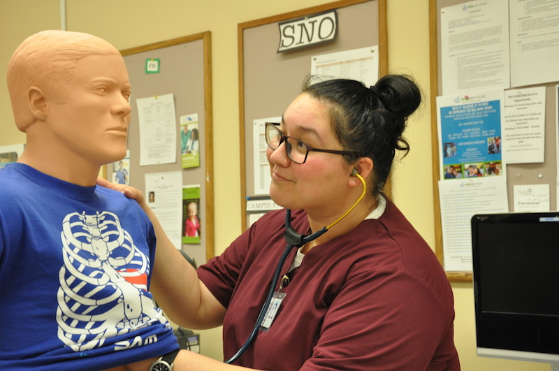 student with nursing mannequin