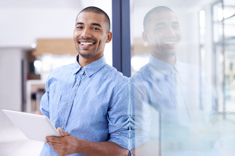 young man leaning back with smile