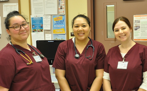 three nursing students smiling