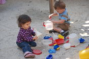 toddlers in sand