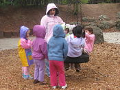 children & tire swing