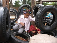 child on tires