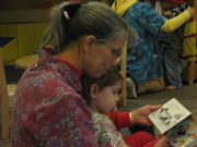 corine reads to child