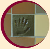 Print of child's hand on tiled wall