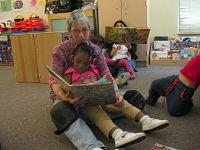 corrine reading to toddler
