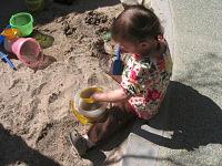 Toddler with sand