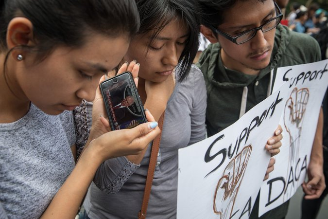 Three DACA recipients — Sofia Ruales, left; her sister Erica Ruales; and their cousin Marlon Ruales — listened to Attorney General Jeff Sessions's announcement.