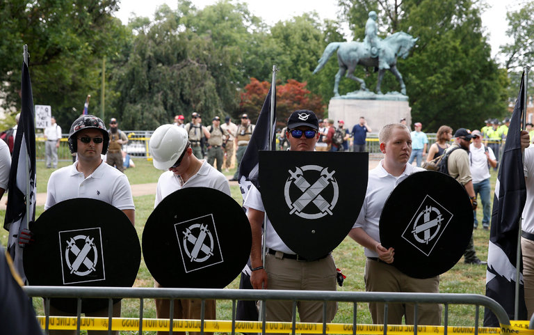 Participants at a rally of white supremacists gathered near a statue of Robert E. Lee in Charlottesville, Va.