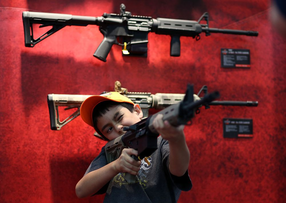 boy holding assault rifle