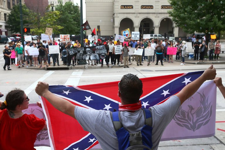 protesters holding confederate flag