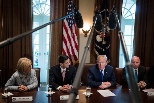 President Donald Trump, flanked by Speaker of the House Paul Ryan, left, and Rep. Kevin Brady, the House Ways and Means Committee chairman, speaks about tax reform legislation