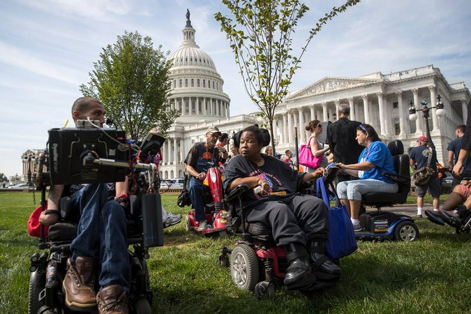 Members of a disability rights group at a news conference opposing the Republican health bills