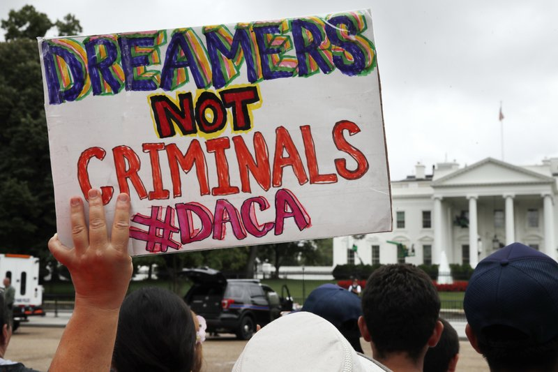 "protest sign: ""Dreamers not Criminals"""
