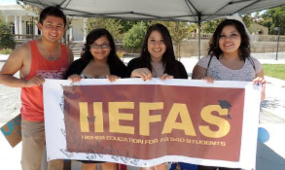 Group of students holding HEFAS sign