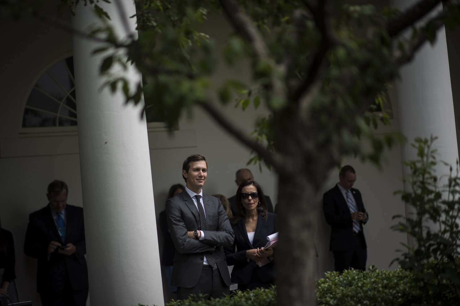 White House senior adviser Jared Kushner listens as President Trump speaks
