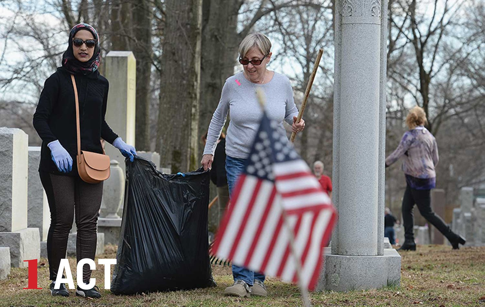 Two women volunteers clean up a Jewish cemetery that was vandalized.