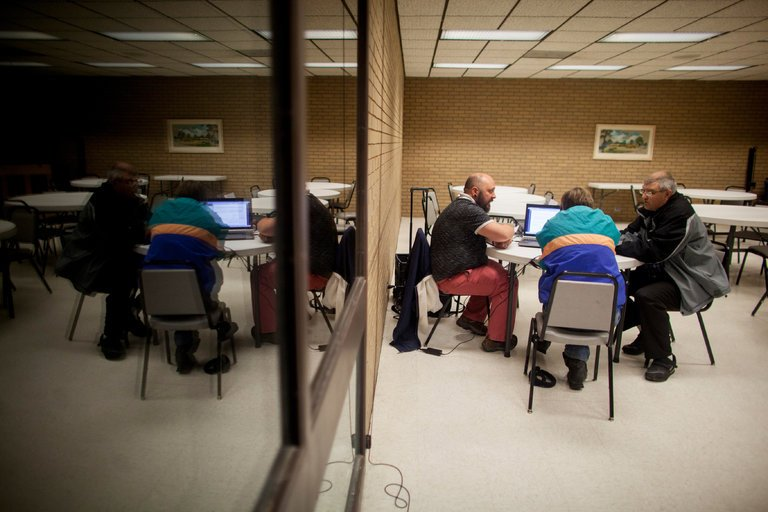 A navigator from Planned Parenthood of the Heartland, left, helped a couple enroll in a health care plan .