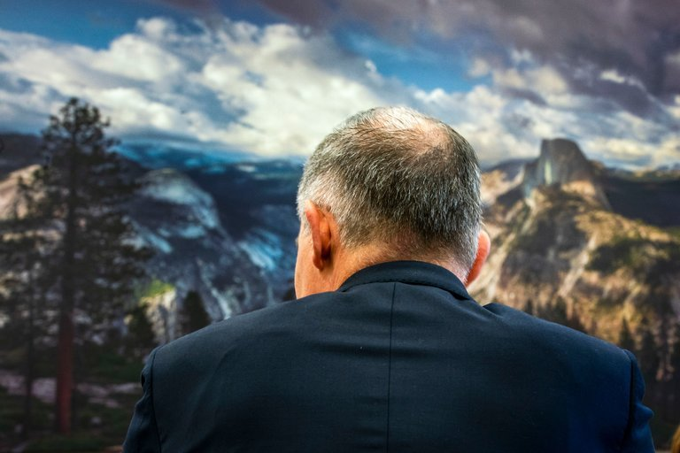 Scott Pruitt, facing a photograph of Yosemite National Park
