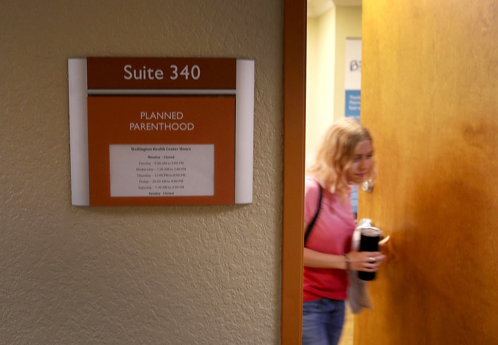 A patient leaving a Planned Parenthood clinic