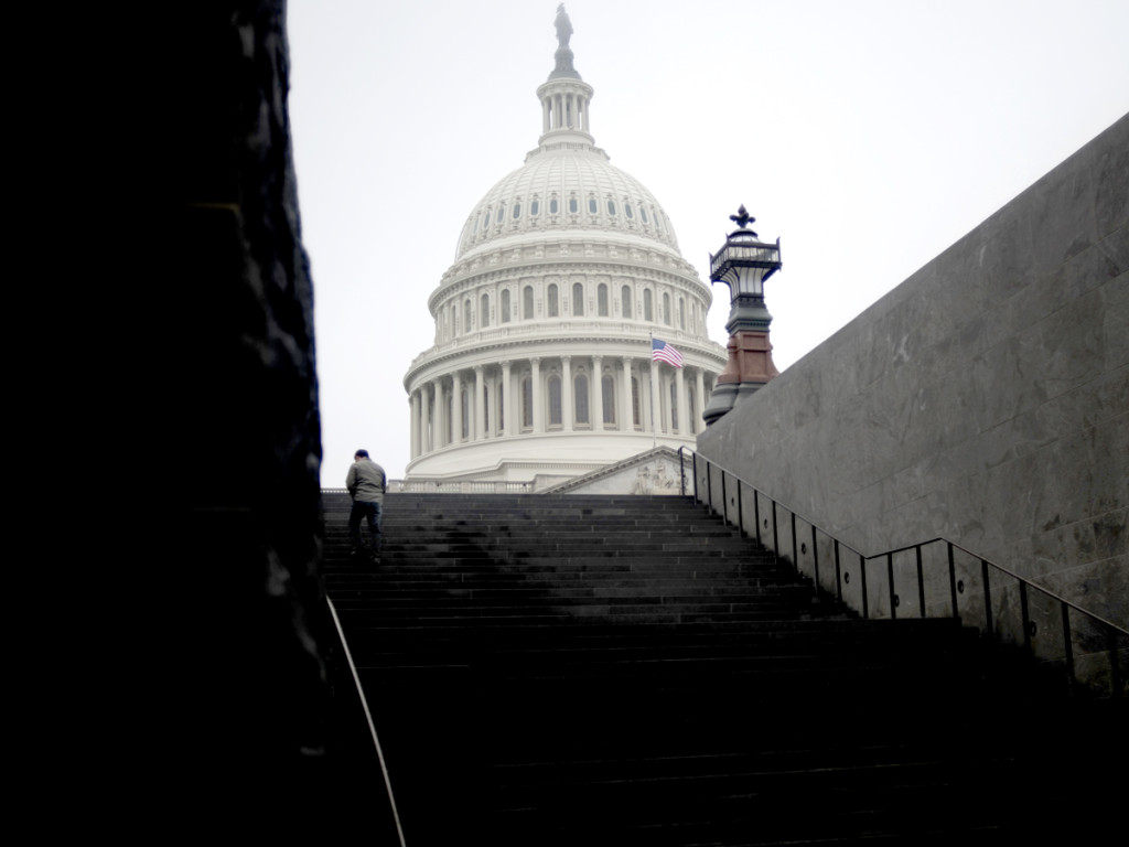 A man walks up the steps outside of the U.S. Capitol