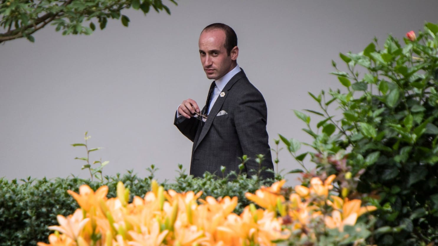 Senior policy adviser Stephen Miller walks through the colonnades of the White House