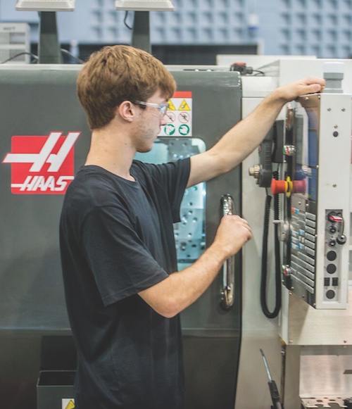 male student at Haas machine