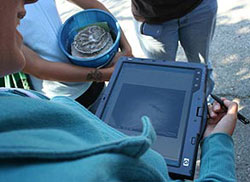 Female student holding HP tablet