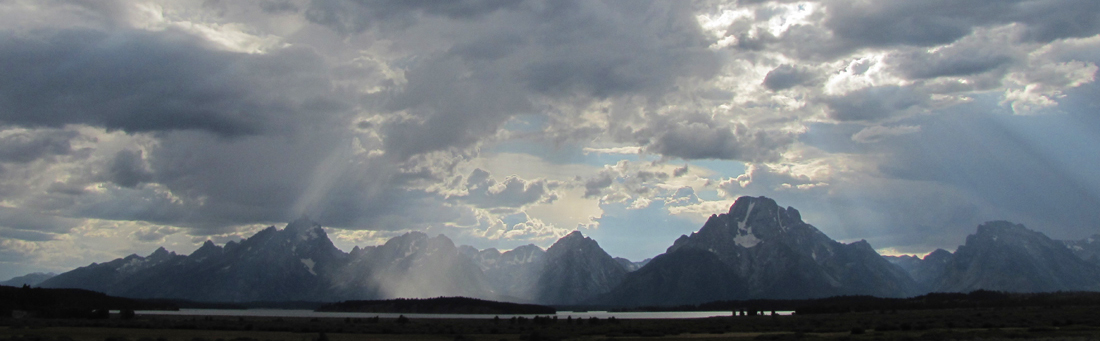 Teton range with clouds and rays of sun