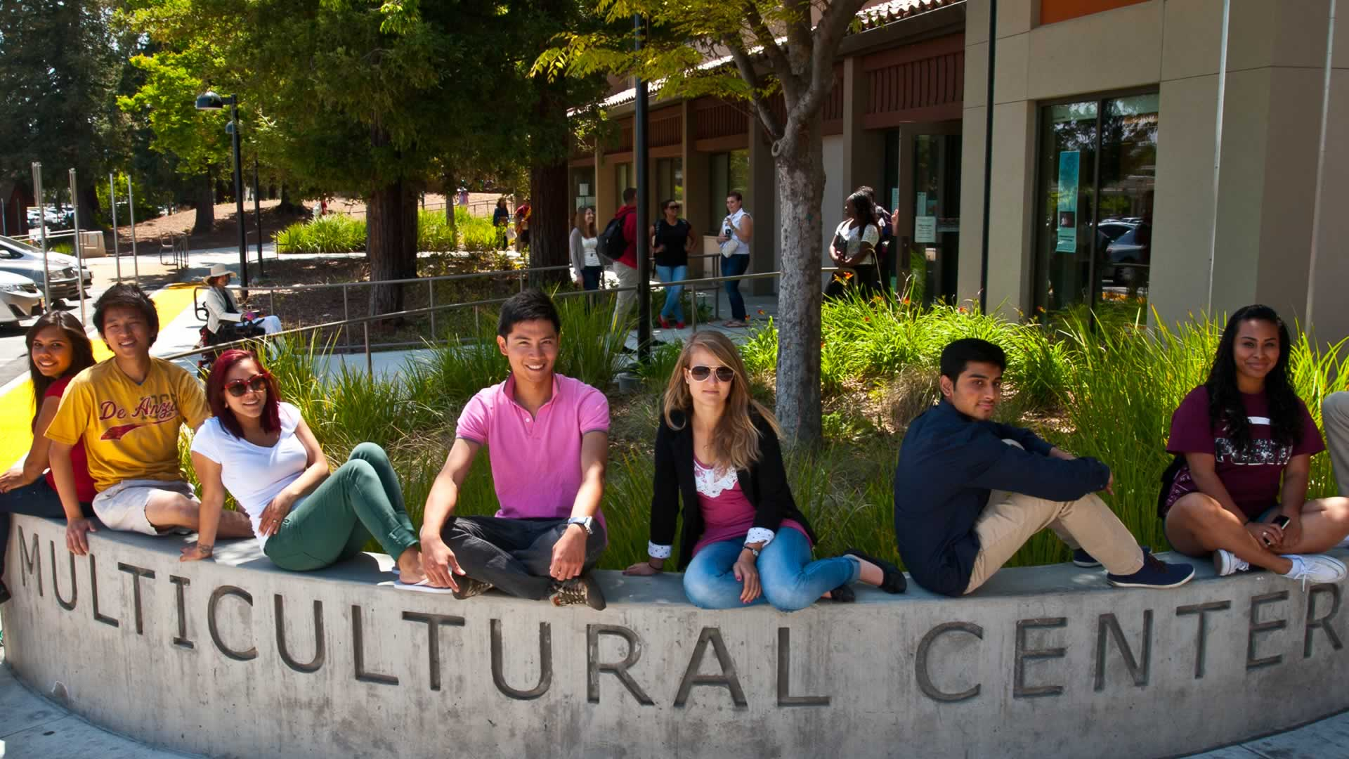 Students on the Multicultural Center sign