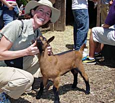 Instructor with a goat during a  class field trip