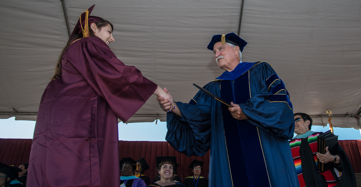 President Murphy with graduate