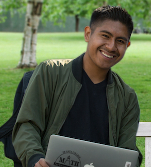 smiling young man with laptop computer