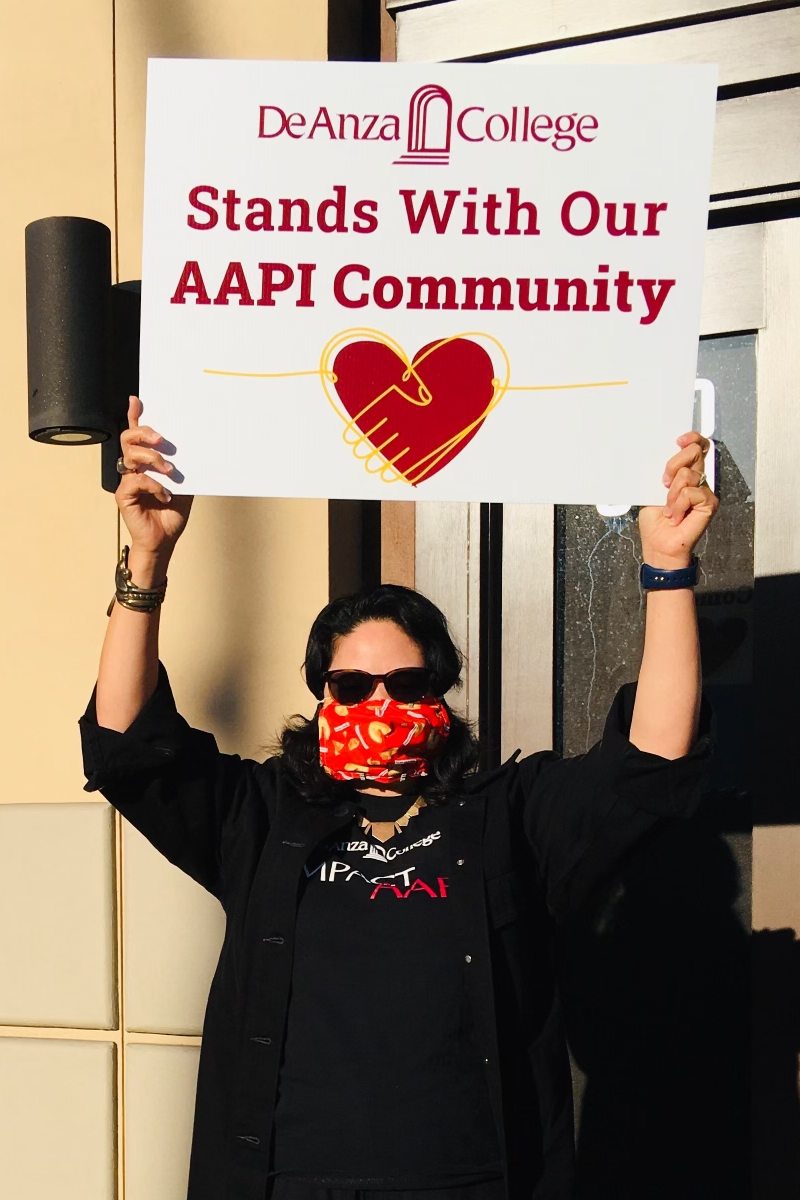 Karen Chow with sign: De Anza College Stands With Our AAPI Community