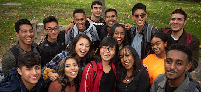 group of smiling students on campus