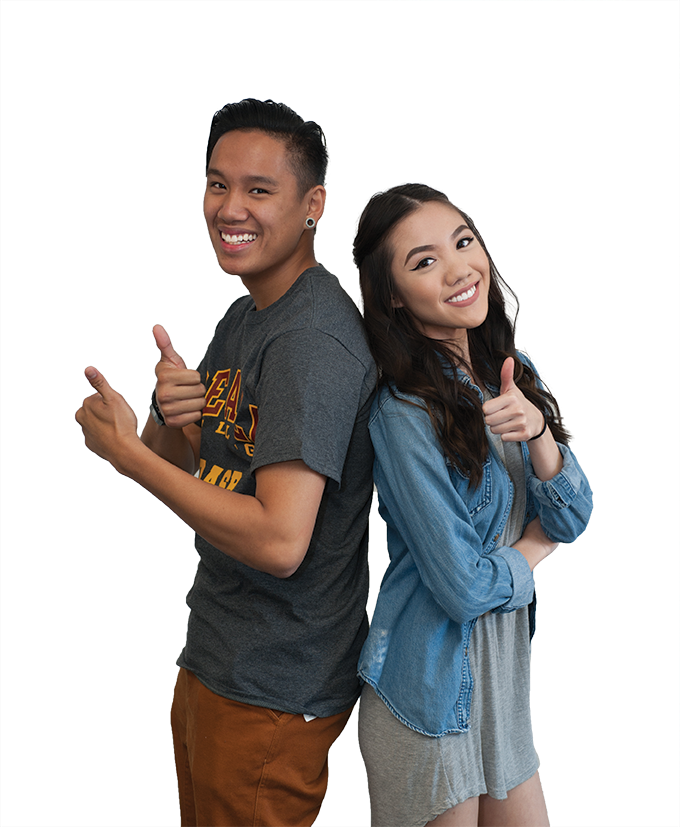 two students standing with thumbs up
