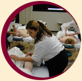 Massage therapy program students working on clients