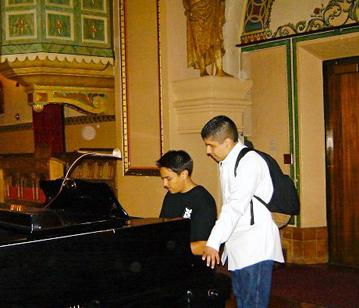 Puente students playing piano in Santa Clara University Chapel
