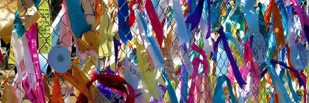 colorful ribbons on a fence