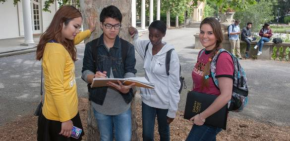 students looking over notebook