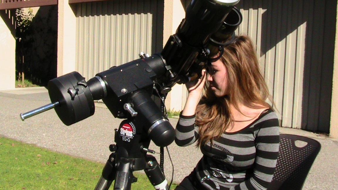 Female student looking through Telescope