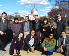 A group of 10 De Anza Public Policy students taking a photo in front of the capital building on a sunny day